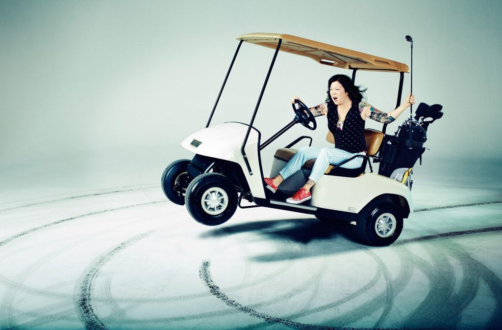 Margaret Cho on a golf cart making donuts spinning around fast and furious