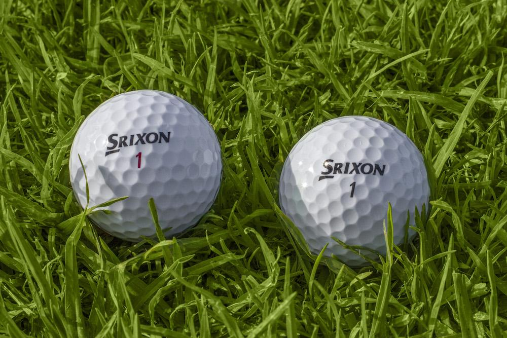 2 white Srixon Z Balls on the golf course close up