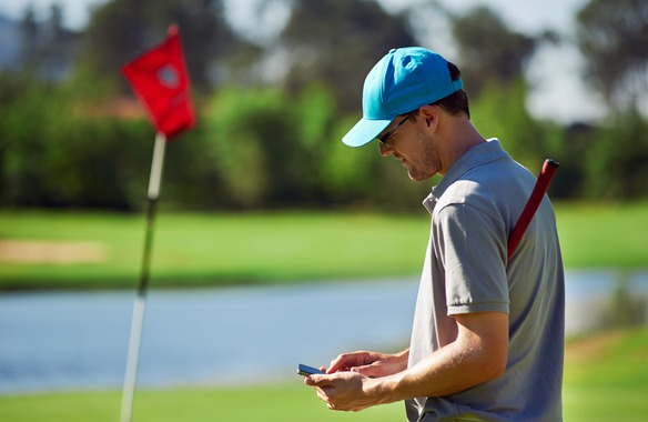 golfer using mobile phone