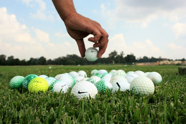 golf ball being picked up by business people