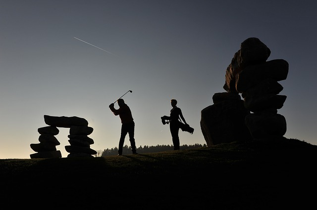business people playing golf at break of dawn